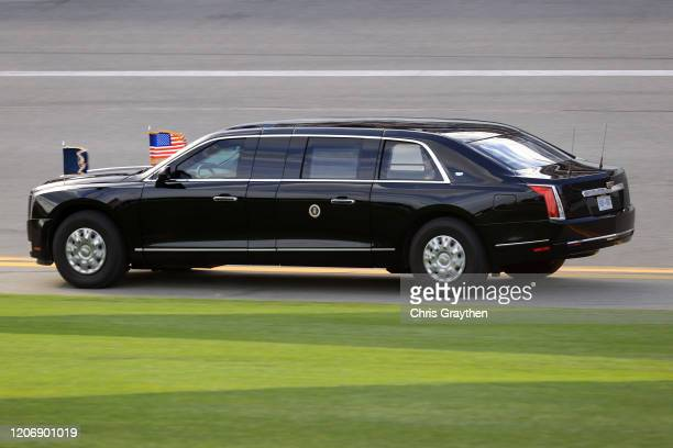 President Donald Trump and First Lady Melania Trump ride in the limousine, known as the Beast on the track prior to the NASCAR Cup Series 62nd Annual...