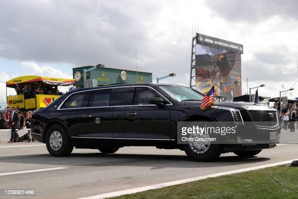 President Donald Trump and First Lady Melania Trump ride in the limousine, known as the Beast on pit road prior to the NASCAR Cup Series 62nd Annual...