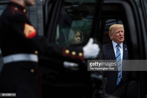 President Donald Trump and first lady Melania Trump seen through a car door walk out to greet Panamanian President Juan Carlos Varela on the South...