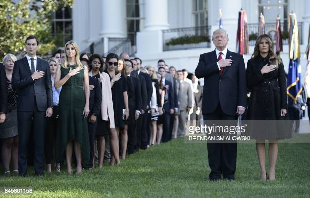 President Donald Trump and First Lady Melania Trump senior advisor Jared Kushner and Ivanka Trump observe a moment of silence on September 11 at the...