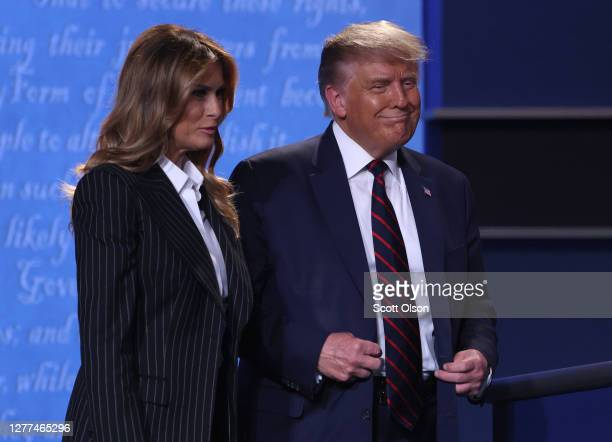 President Donald Trump and first lady Melania Trump smile on stage after the first presidential debate between Trump and Democratic presidential...