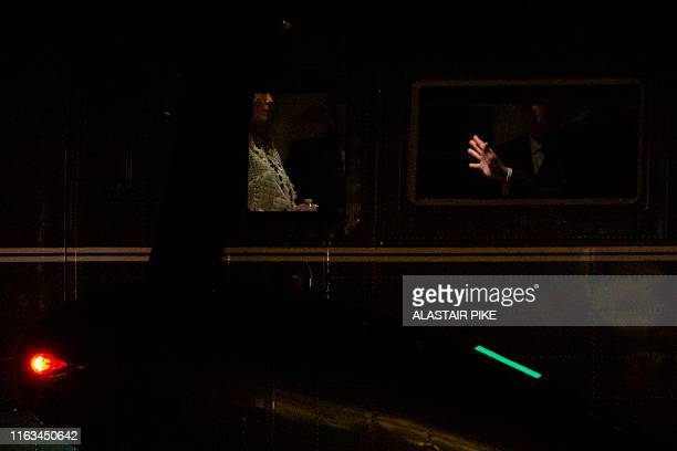 US President Donald Trump and First Lady Melania Trump speak on Marine One as they depart the White House in Washington DC on August 23 for the G7...