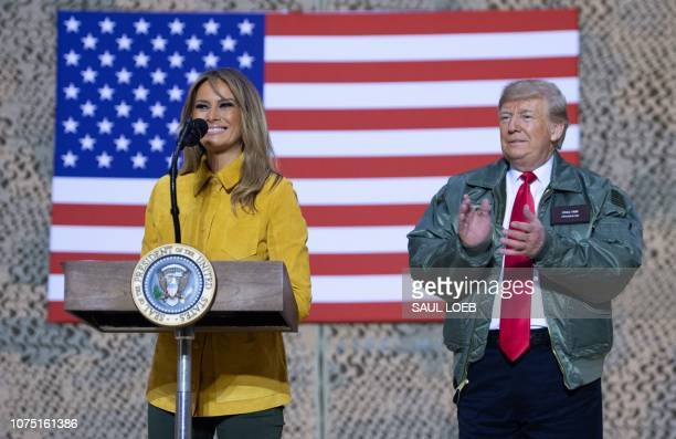 US President Donald Trump and First Lady Melania Trump speak to members of the US military during an unannounced trip to Al Asad Air Base in Iraq on...