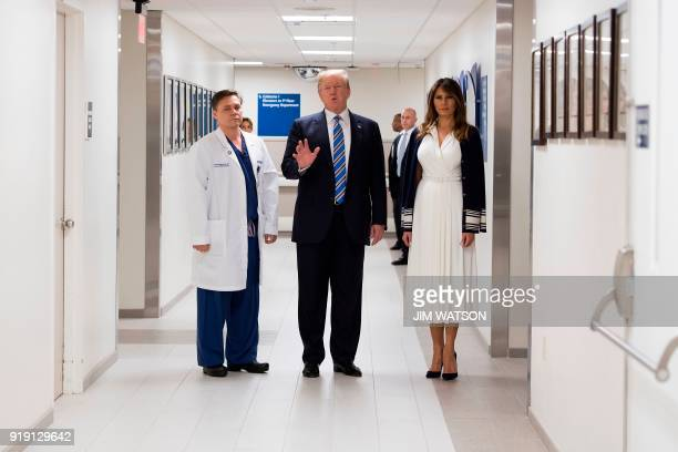 US President Donald Trump and First Lady Melania Trump speak while visiting first responders at Broward Health North hospital in Pompano Beach...