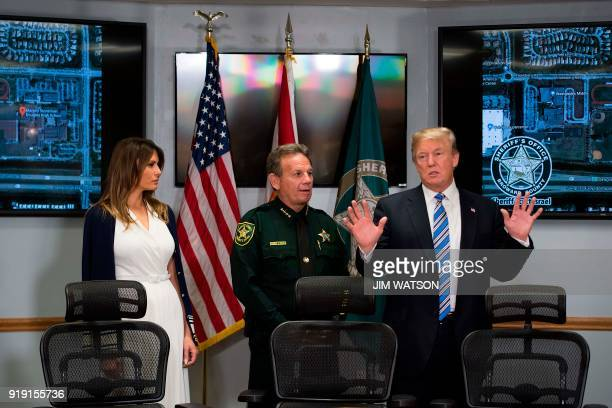 President Donald Trump and First Lady Melania Trump speak with Broward County Sheriff Scott Israel while visiting first responders at Broward County...