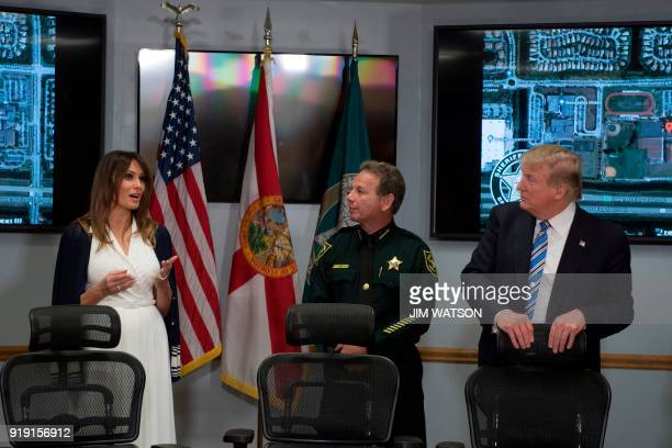 US President Donald Trump and First Lady Melania Trump speak with Broward County Sheriff Scott Israel while visiting first responders at Broward...