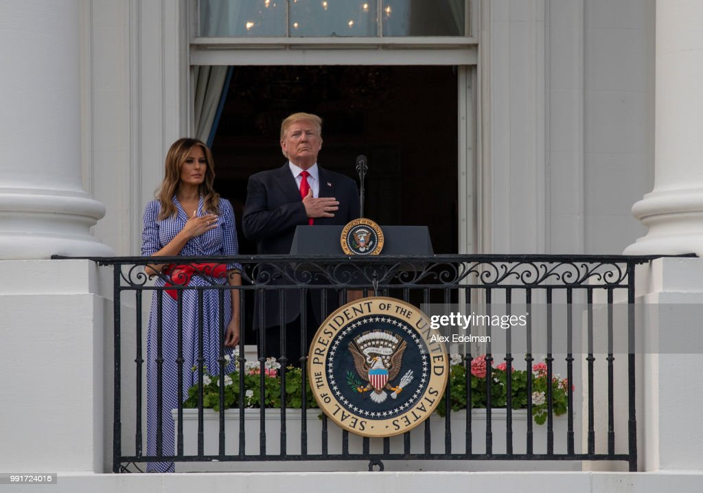 US President Donald Trump and first lady Melania Trump stand for the National Anthem during a picnic for military families on the South Lawn of the White House on July 4, 2018 in Washington, DC.