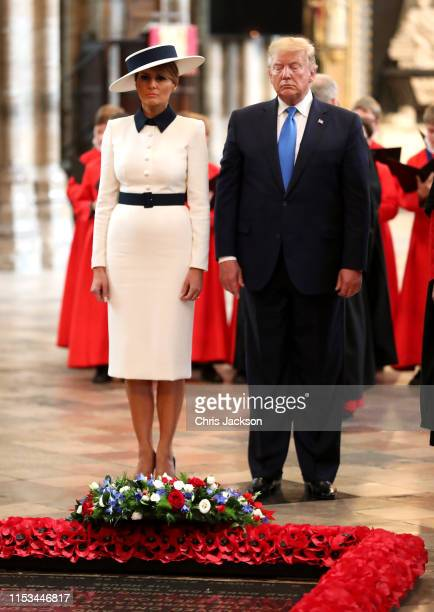 President Donald Trump and First Lady Melania Trump stand in silence after laying a wreath at the Grave of the Unknown Warrior during their visit to...