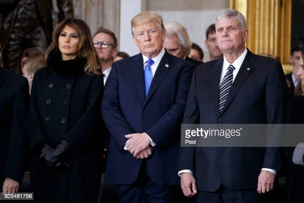 President Donald Trump and first lady Melania Trump stand with Franklin Graham during a ceremony as the late evangelist Billy Graham lies in repose...