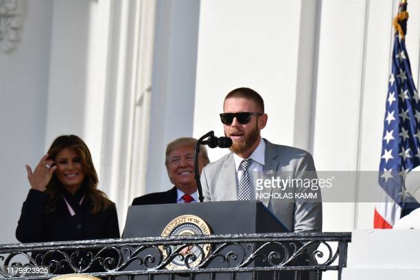 US President Donald Trump and First Lady Melania Trump stand with pitcher Stephen Strasburg as they welcome the 2019 World Series Champions The...