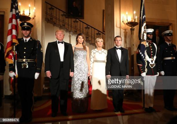 President Donald Trump and First Lady Melania Trump stand with French President Emmanuel Macron and his wife Brigitte Macron at the start of a State...