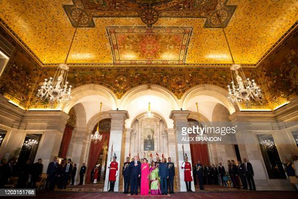 US President Donald Trump and First Lady Melania Trump stand with India's President Ram Nath Kovind and his wife Savita Kovind during a state banquet...