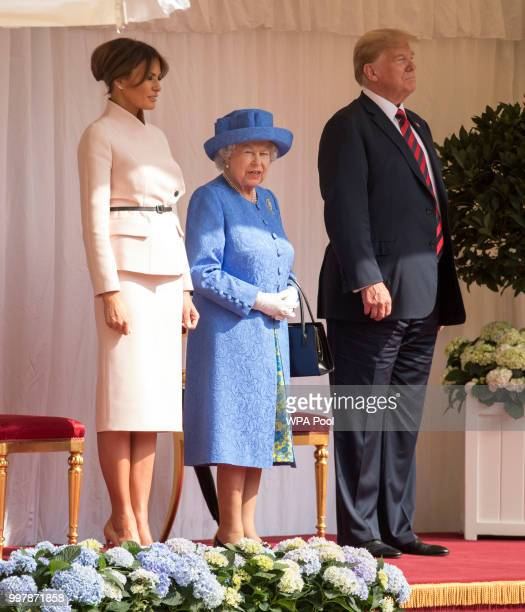 S President Donald Trump and first lady Melania Trump stand with Britain's Queen Elizabeth II on the dais in the Quadrangle of Windsor Castle on July...