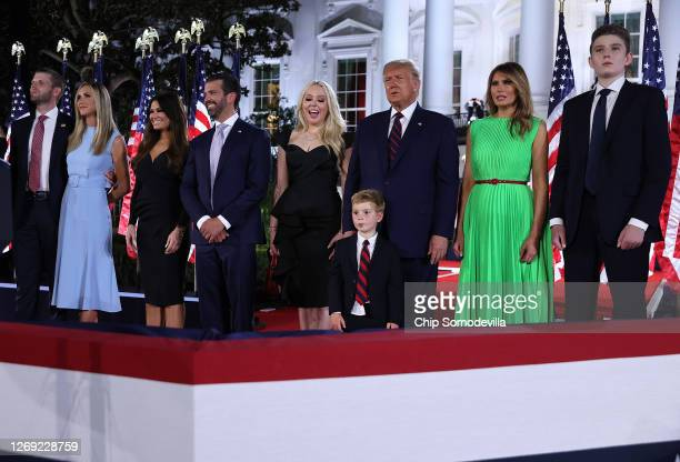 President Donald Trump and first lady Melania Trump stand with their family members following his acceptance speech for the Republican presidential...
