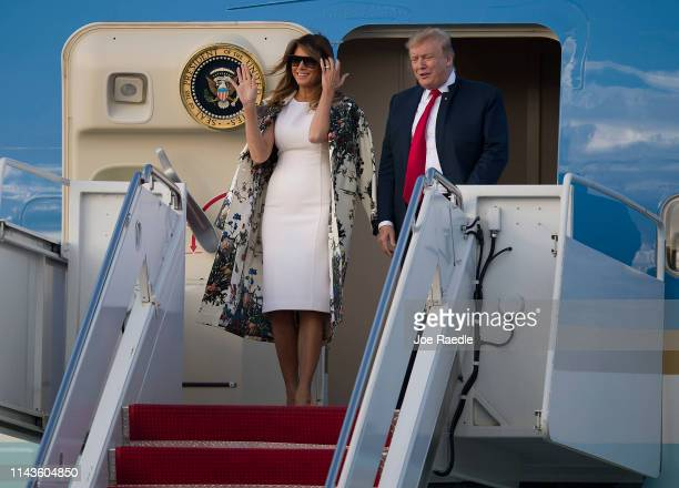 President Donald Trump and First Lady Melania Trump step from Air Force One at the Palm Beach International Airport to spend Easter weekend at his...
