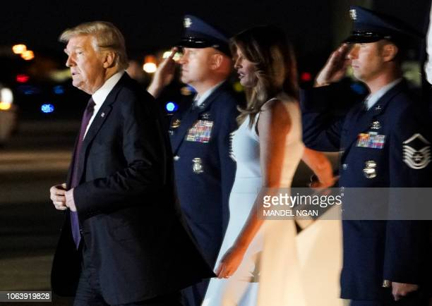US President Donald Trump and First Lady Melania Trump step off Air Force One upon arrival at Palm Beach International Airport in West Palm Beach...
