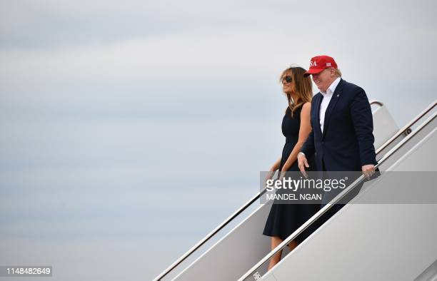US President Donald Trump and First Lady Melania Trump step off Air Force One upon arrival at Andrews Air Force Base in Maryland on June 07 2019