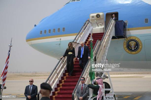 President Donald Trump and First Lady Melania Trump step off Air Force One upon arrival at King Khalid International Airport in Riyadh on May 20,...