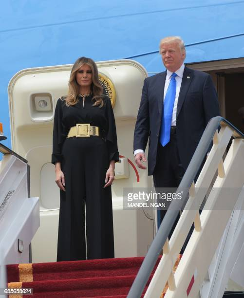 US President Donald Trump and First Lady Melania Trump step off Air Force One upon arrival at King Khalid International Airport in Riyadh on May 20...