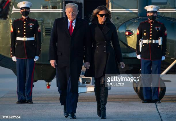 President Donald Trump and First Lady Melania Trump step off Marine One on their way to board Air Force One prior to departure from Joint Base...