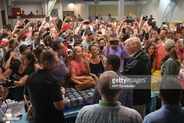 US President Donald Trump and First Lady Melania Trump take part in a food and suplly distribution at the Cavalry Chapel in Guaynabo Puerto Rico on...