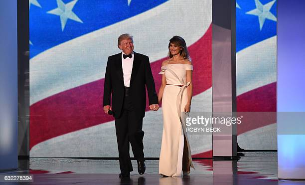 US President Donald Trump and First Lady Melania Trump take the stage at the Freedom Inaugural Ball January 20 in Washington DC / AFP / Robyn Beck