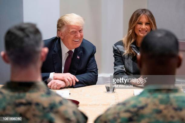 US President Donald Trump and First Lady Melania Trump talk with US Marines as they visits the Marine Barracks in Washington DC on November 15 2018...