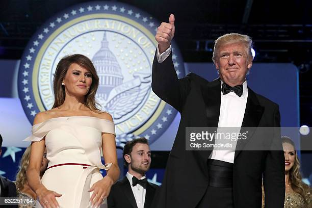 S President Donald Trump and first lady Melania Trump thank guests during the inaugural Freedom Ball at the Washington Convention Center January 20...