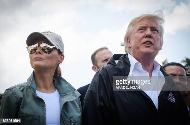 US President Donald Trump and First Lady Melania Trump tour a storm damaged residential area in Guaynabo Puerto Rico on October 3 2017 Nearly two...