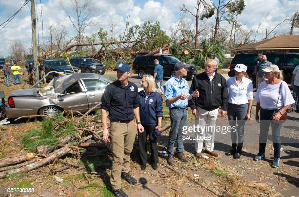US President Donald Trump and First Lady Melania Trump tour damage from Hurricane Michael in Lynn Haven Florida October 15 2018