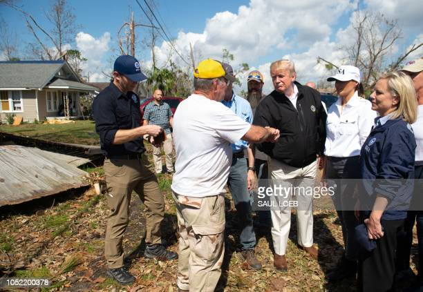 US President Donald Trump and First Lady Melania Trump tour damage from Hurricane Michael in Lynn Haven Florida October 15 2018 along with DHS...