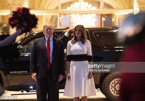 President Donald Trump and First Lady Melania Trump view the Florida Atlantic University Marching Band perform at the Trump International Golf Club...