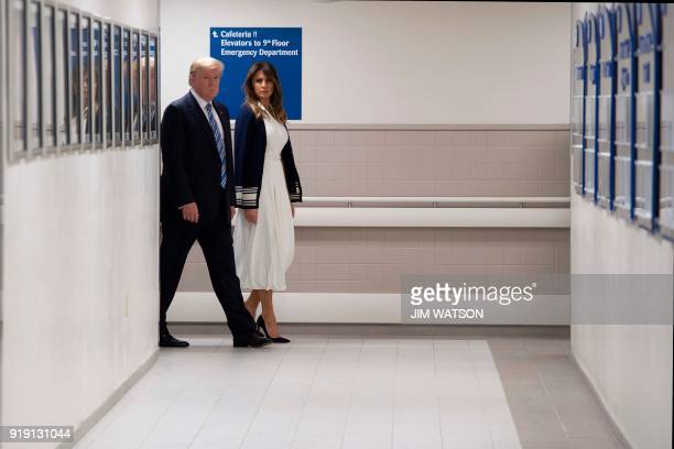 US President Donald Trump and First Lady Melania Trump visit first responders at Broward Health North hospital Pompano Beach Florida on February 16...