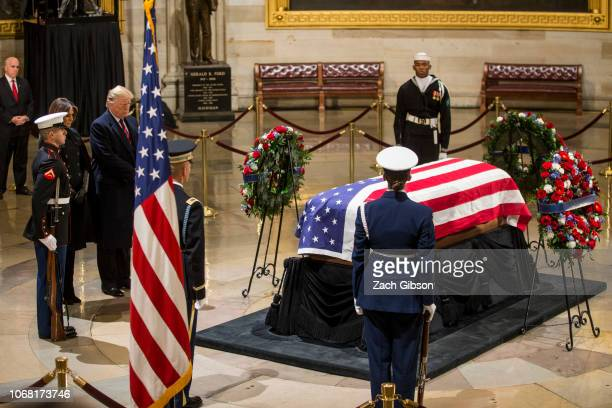 President Donald Trump and First Lady Melania Trump visit the Capitol Rotunda as former US President George HW Bush lies in state on December 3 2018...