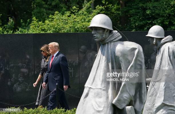 US President Donald Trump and First Lady Melania Trump visit the Korean War Veterans Memorial in Washington DC on June 25 2020 North and South Korea...