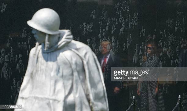 President Donald Trump and First Lady Melania Trump visit the Korean War Veterans Memorial in Washington DC on June 25 2020 North and South Korea on...