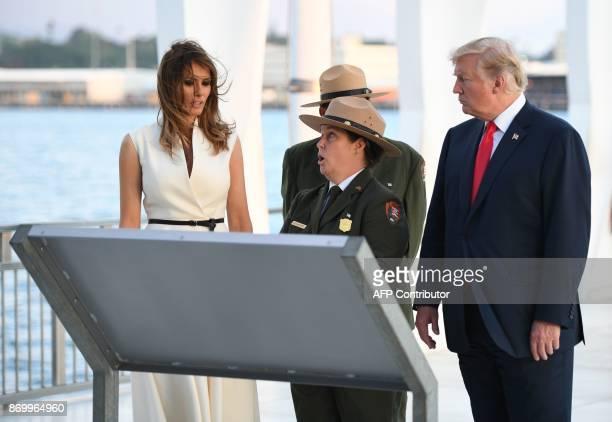 US President Donald Trump and First Lady Melania Trump visit the USS Arizona Memorial on November 3 at Pearl Harbor in Honolulu Hawaii / AFP PHOTO /...