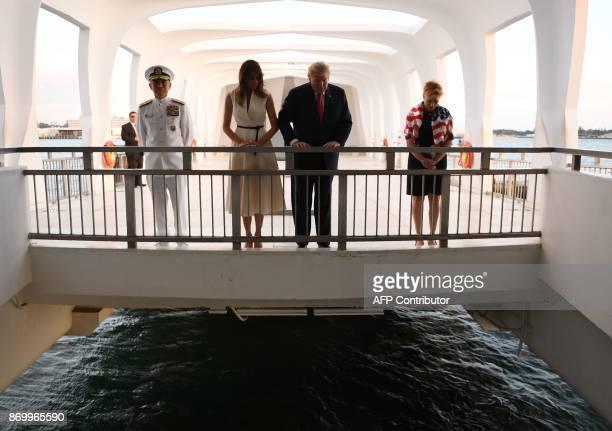 US President Donald Trump and First Lady Melania Trump visit the USS Arizona Memorial on November 3 at Pearl Harbor in Honolulu Hawaii Admiral Harry...