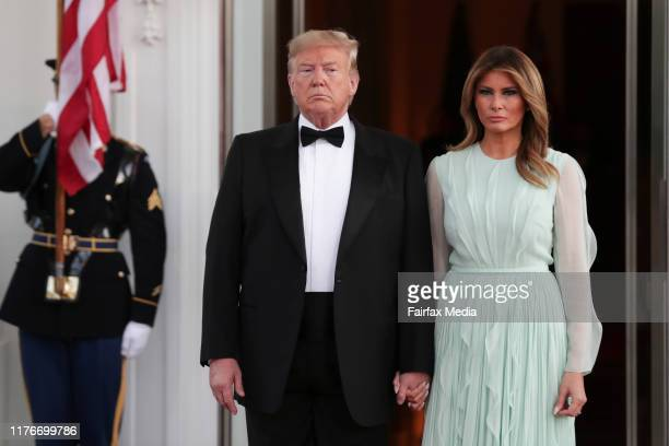 President Donald Trump and First Lady Melania Trump wait for the arrival of Australian Prime Minister Scott Morrison and his wife, Jenny Morrison,...