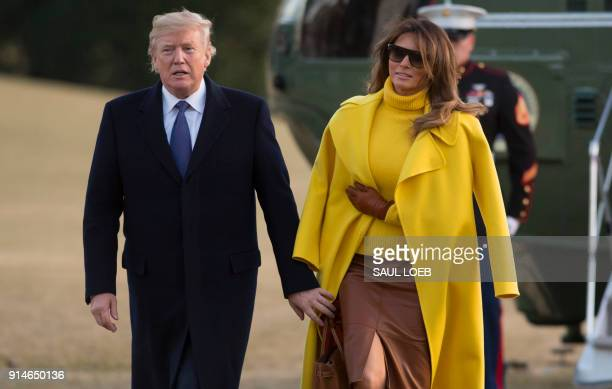 US President Donald Trump and First Lady Melania Trump walk across the South Lawn upon arrival on Marine One at the White House in Washington DC...