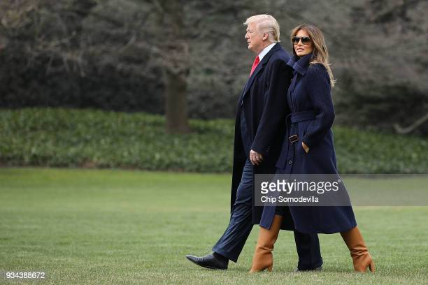 S President Donald Trump and first lady Melania Trump walk across the South Lawn as they leave the White House March 19 2018 in Washington DC The...