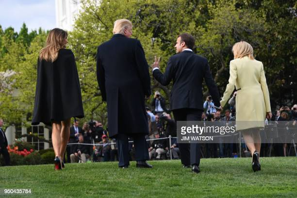 US President Donald Trump and First Lady Melania Trump walk after a tree planting ceremony with French President Emmanuel Macron and his wife...