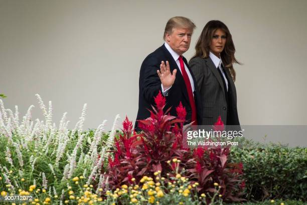 President Donald Trump and first lady Melania Trump walk along the colonnades at the White House in Washington DC on Wednesday Oct 11 2017