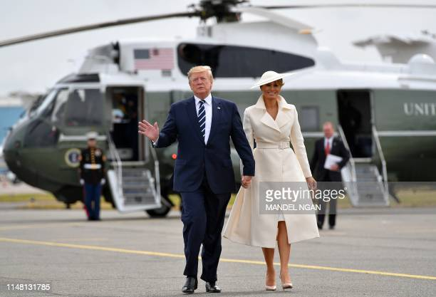 US President Donald Trump and First Lady Melania Trump walk from Marine One to board Air Force One before departing from Southampton Airport in...