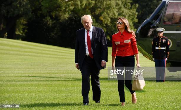 US President Donald Trump and First Lady Melania Trump walk from Marine One upon arrival on the South Lawn of the White House September 10 2017 in...
