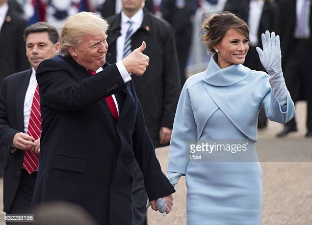 President Donald Trump and first lady Melania Trump walk in their inaugural parade on January 20 2017 in Washington DC Donald Trump was swornin as...