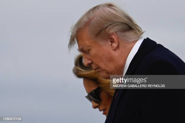 President Donald Trump , and first lady Melania Trump walk off Air Force One after arriving at Andrews Airforce base, Maryland on December 31, 2020.