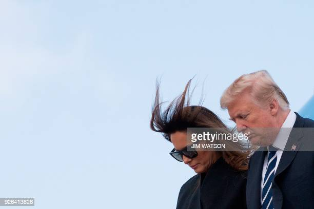 US President Donald Trump and First Lady Melania Trump walk off Air Force One as they arrive in West Palm Beach Florida on March 2 2018 / AFP PHOTO /...