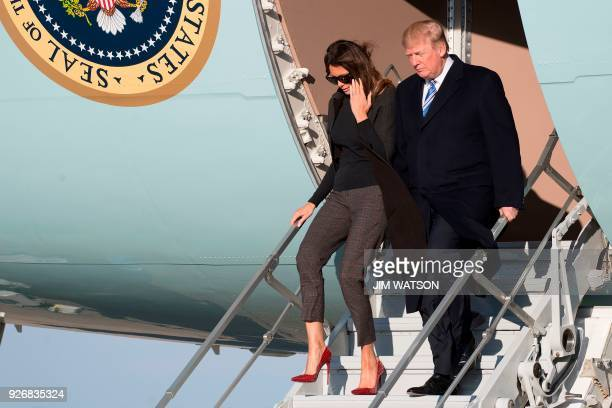 US President Donald Trump and First Lady Melania Trump walk off Air Force One at Andrews Air Force Base Maryland on March 3 2018 / AFP PHOTO / JIM...