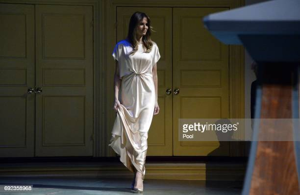 President Donald Trump and First Lady Melania Trump walk on stage during the annual gala at the Ford's Theatre to honor President Abraham Lincoln's...